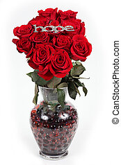 The word hope in silver on red roses