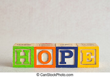 The word hope spelled with colorful blocks isolated on a white background