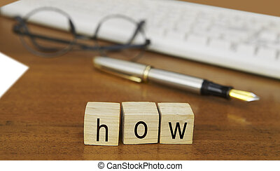 The word how on wood stamp