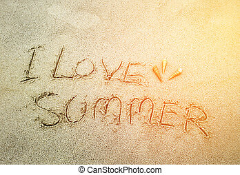 The word i love summer in the sand with burst light