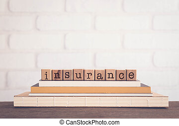 The word INSURANCE letters and copy space background, vintage.