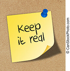 "The word "" keep it real "" pinned to a cork board."