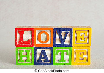 The word love and hate spelled with colorful alphabet blocks isolated on white background