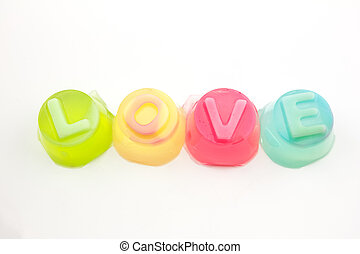 """word """"love"""" in jelly isolated on white background"""