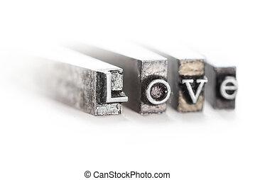 """The word """"love"""" in letterpress type"""