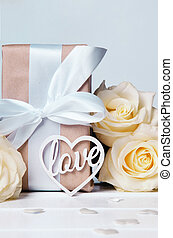 The word love in white letters on gift boxes with white ribbons. Love concept, Valentine's day