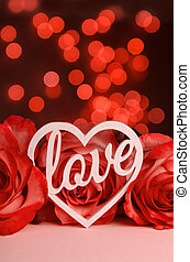 The word love in white letters on light background. Valentine's Day, Mother's Day, World Women's Day holiday concept