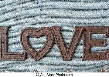 The Word Love On Blue Background