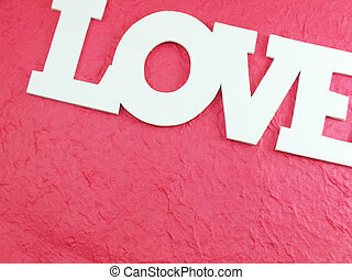 the word love on pink background