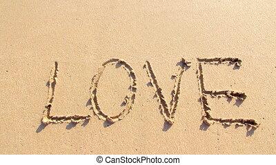 The word love on sand beach