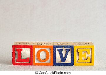 The word love spelled with colorful blocks isolated on a white background
