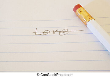 The word love written on paper and crossed out.
