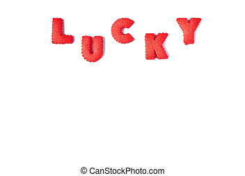 The word LUCKY spelled with red colored alphabet shaped biscuits on white background