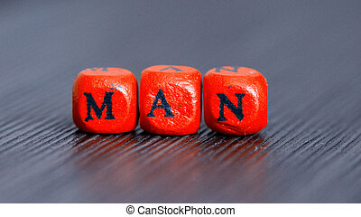 The word man on colored cubes