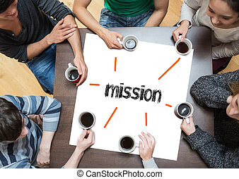 The word mission on page with people sitting around table...
