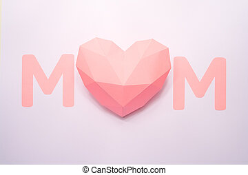 the word mom, cut out of paper