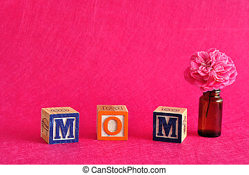 The word mom spelled with alphabet