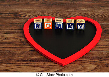 The word mommy spelled on heart sha
