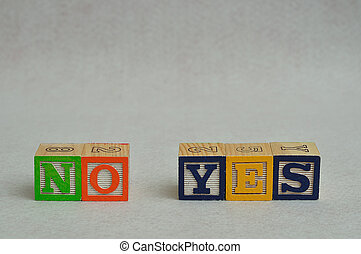 The word no and yes spelled with colorful alphabet blocks isolated against a white background
