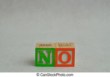 The word no spelled with colorful alphabet blocks isolated against a white background