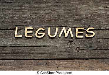 The word of Legumes on a wooden table