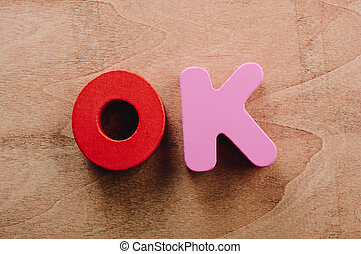 the word OK written with letter blocks