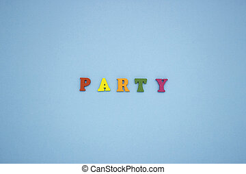 The word PARTY on a blue background of wooden multicolored letters.