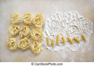 the word pasta written with the flour