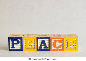 The word peace spelled with colorful alphabet blocks isolated against a white background
