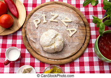 the word pizza with dough