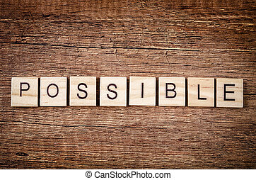 The word Possible spelled with wood blocks.