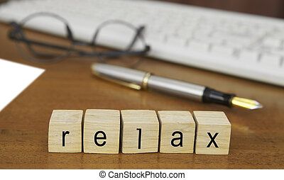 The word relax on wood stamp