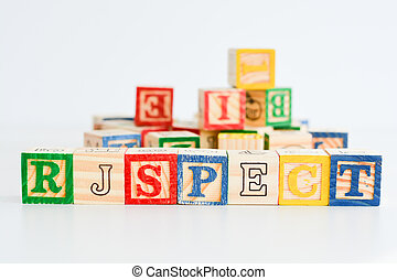 "The word ""respect"" spelled with wooden letter cubes"