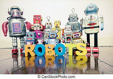 the word robots with wooden letters and retro toy robots on an old wooden