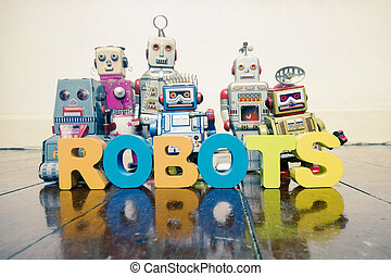 the word robots with wooden letters and retro toy robots on an old wooden floor