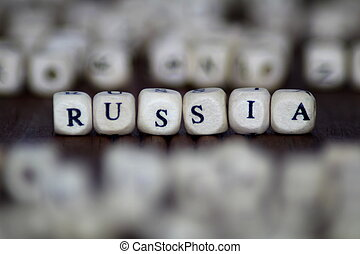 """The word """"RUSSIA"""" written in vintage, wooden cubes"""