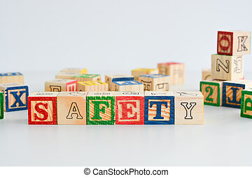 "The word ""safety"" spelled with wooden letter cubes"