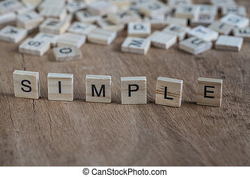 the word simple written with cube letters