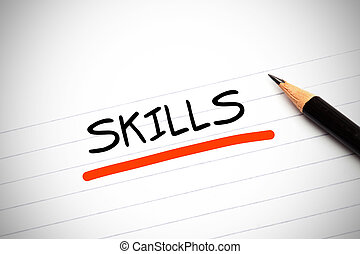 The word skills written on a notepad with a pencil and underlined in red