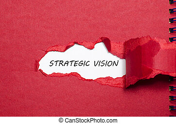 The word strategic vision appearing behind torn paper