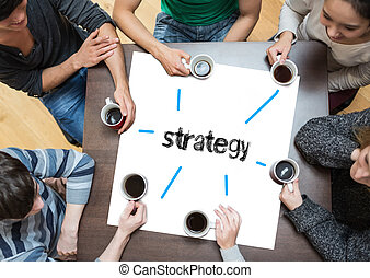 The word strategy on page with people sitting around table drinking coffee