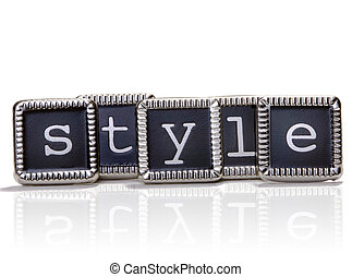 """The word """"style"""" spelled out with elegant metal letters."""