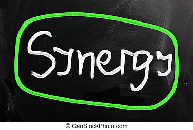 "The word ""Synergy"" handwritten with white chalk on a blackboard"