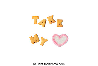 The Word TAKE MY HEART spelled with alphabet shaped cookies and a heart shaped marshmallow candy on white background