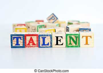 "The word ""talent"" spelled with wooden letter cubes"