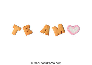 The word TE AMO Meaning I LOVE YOU in Spanish spelled with alphabet shaped biscuits and a heart shaped marshmallow candy on white background