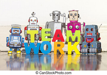 the word TEAM WORK with wooden letters and 5 retro bots