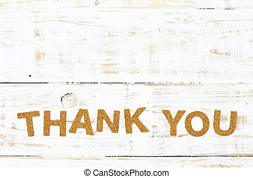 the word thank you cork on white wood background