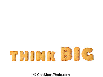 The word THINK BIG spelled with alphabet shaped cookies isolated on white background