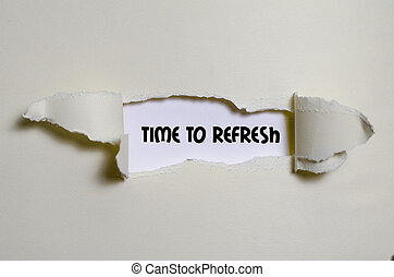 The word time to refresh appearing behind torn paper